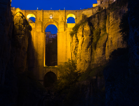 ronda: Ancient stone bridge  in night.  Ronda, Spain