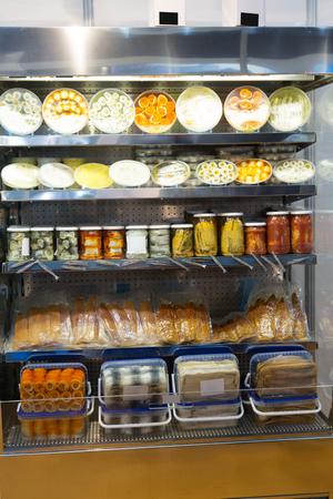 provision: Many packed sea provision on shop shelf