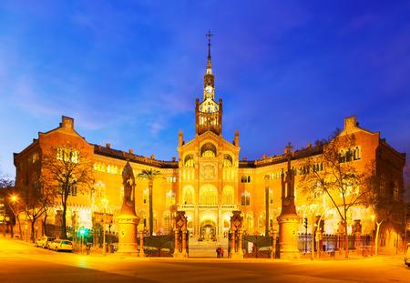 modernisme: Main facade of Hospital de Sant Pau in night. Barcelona, Catalonia