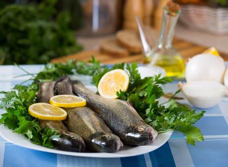 grig: Uncooked eel fish, parsley, salt and lemon - ingredients for cooking