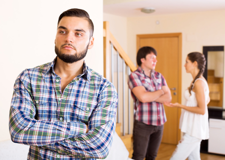 polygamy: Quarrel in adult polygamous family indoors in the living room