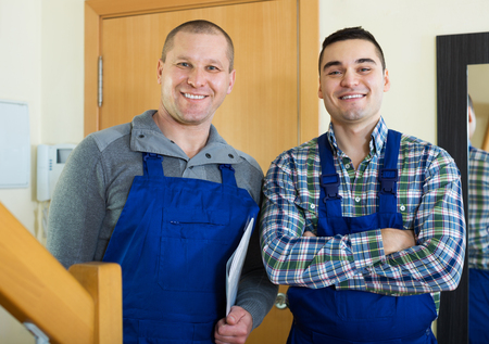 came: Workmen came together to the house to fix the problem Stock Photo