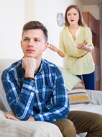the spouse: person criticizing young spouse in living room Stock Photo