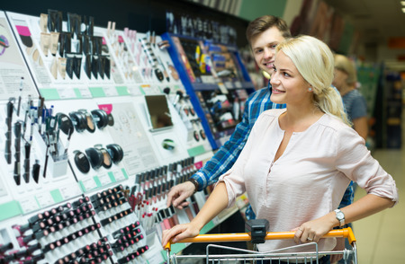 beauty shop: family 20-30 years old standing near beauty stand in shop Stock Photo