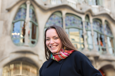 paseig: Portrait of girl tourist with Casa Batllo  in background. Barcelona, Spain Stock Photo