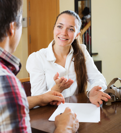 private insurance: Man discussing details of private insurance with smiling agent