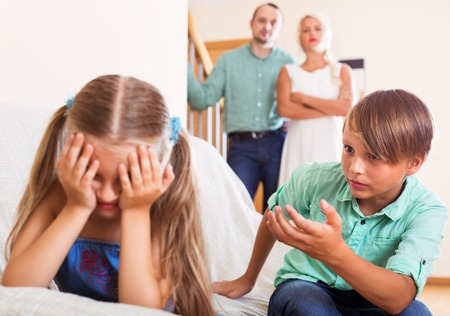 brother sister fight: Brother sister calms crying in the presence of parents