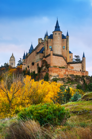 castile: View of Alcazar of Segovia in autumn.  Castile and Leon, Spain