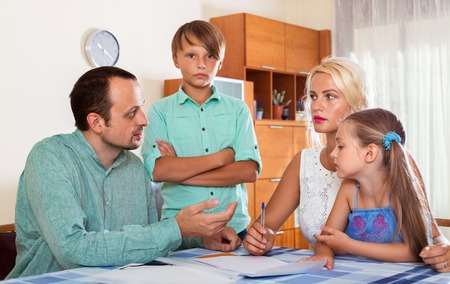 inspector kid: Parents talk about serious financial problems at home Stock Photo