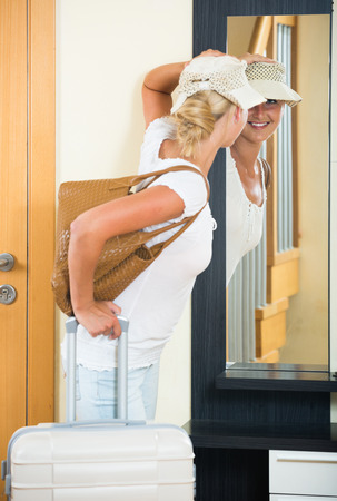 interphone: Portrait of young european female traveller going at holiday trip