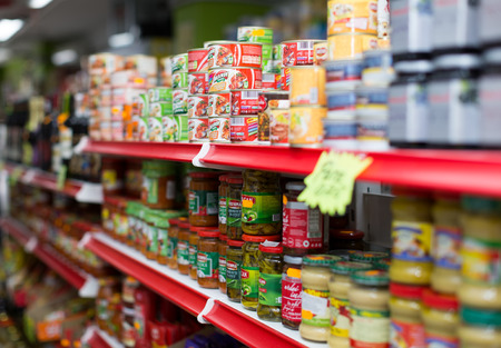 BARCELONA, SPAIN - MARCH 22, 2015: Canned goods at groceries section of average Polish supermarket in Barcelona.