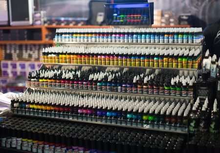17th: BARCELONA, SPAIN - OCTOBER 3, 2014: Many tubes of  tattoo paint at showcase. The 17th edition of The Barcelona Tattoo Expo