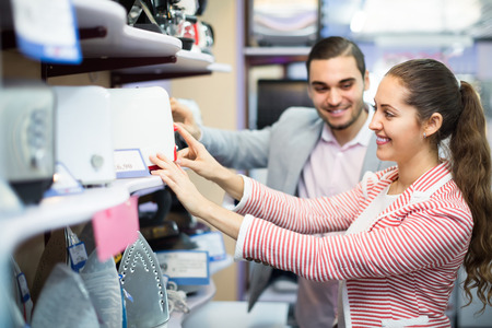 Smiling young customers purchasing toaster in domestic appliances section