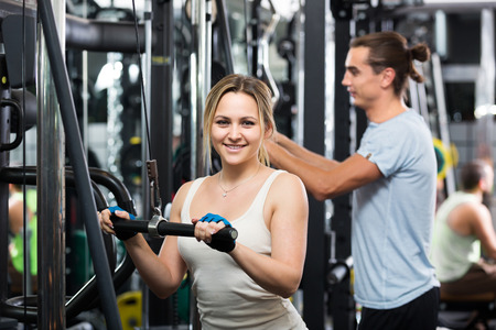 strength training: Adults having strength training under coach control in gym