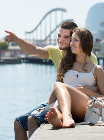 berth: Happy loving couple having romantic date on the berth at sunny day Stock Photo