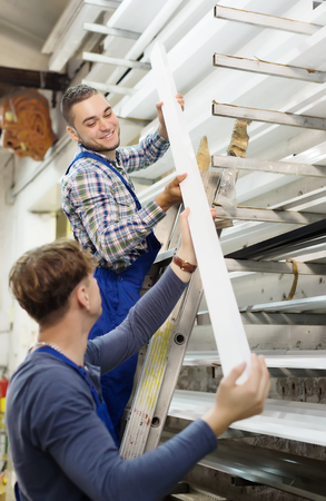 toolroom: Two workers working with  window profile at stand Stock Photo
