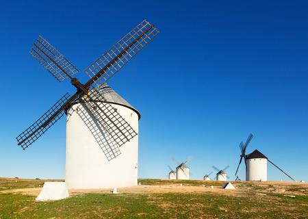 campo: Group of windmills in sunny day. Campo de Criptana, La Mancha, Spain