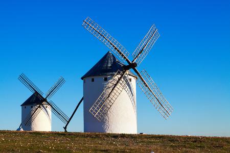 campo: windmills in sunny day. Campo de Criptana, La Mancha, Spain