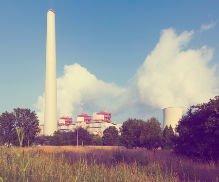 cooling towers: Industrial plant with chimney and cooling towers in sunny summer day Stock Photo
