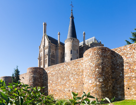 episcopal: Ancient town walls  and Episcopal Palace of Astorga in summer