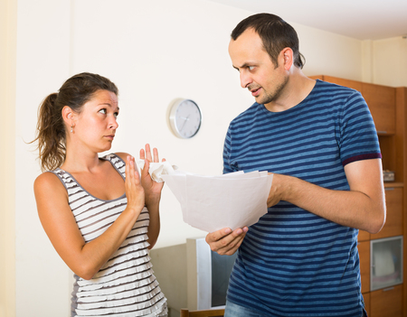 frantic: Quarrel between adult manager and ordinary employee indoors Stock Photo