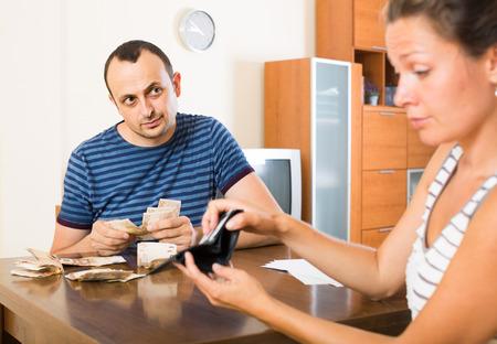 finacial: Casual russian family having finacial problems and debts Stock Photo