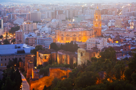 districts: Old residential districts in Malaga with Cathedral in night.  Spain Stock Photo