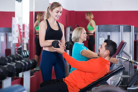 anaerobic: happy  people  weightlifting training in modern health club Stock Photo