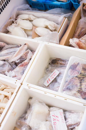 show cases: Assortment of cooled seefoods in show-case at fish market