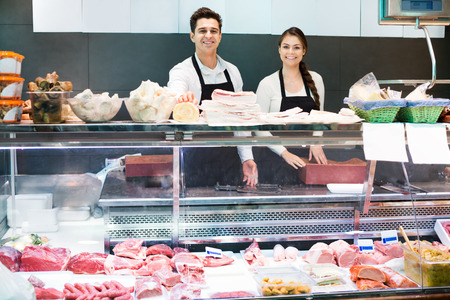 salo: Delicatessen store staff selling fresh-killed a the meat and the salo