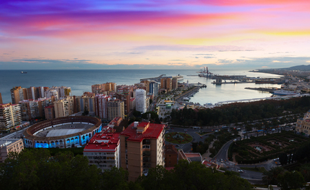 toros: Sunset view of Malaga with Port and Placa de Torros.   Spain