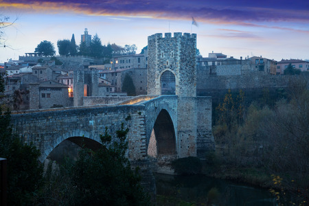 fortifications: Morning viwe of medieval fortifications and bridge. Besalu, Catalonia Editorial