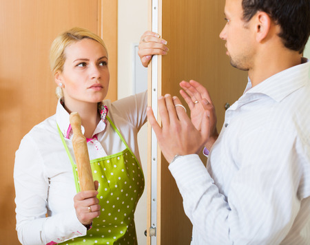 rollingpin: Angry girl threatens with rolling-pin for a frightened man