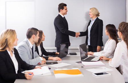 warmly: The head of office warmly greeting new spanish business partner Stock Photo