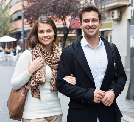 sweet couple: Happy  sweet couple walking in city at autumn day Stock Photo