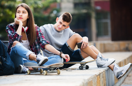 attention: Phubbing: portrait of teenager and friend asking for attention Stock Photo