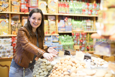 candy store: Portrait of happy young woman shopping in candy store