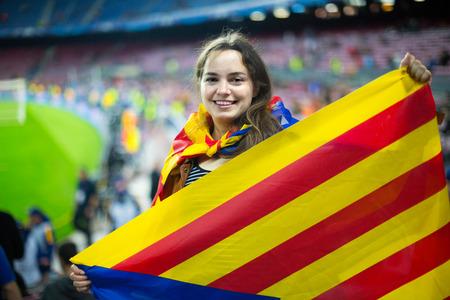 fandom: american female football fan with flag of Catalonia at stadium