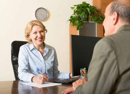 make public: Friendly public notary helping senior client to make a will
