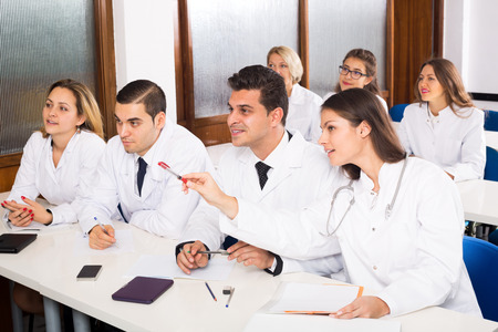 multinational: Multinational interns and professor having discussion at medical faculty