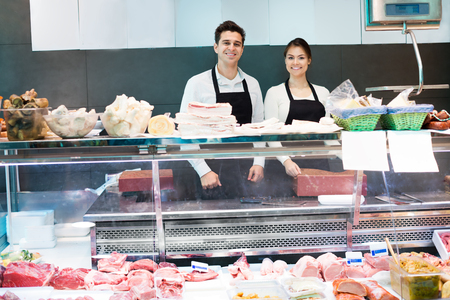 salo: Delicatessen store staff selling fresh-killed meat and salo