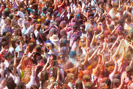 trituration: BARCELONA, SPAIN - APRIL 12, 2015: Happy people during   Festival of colours Holi Barcelona. Holi is traditional holiday of India Editorial