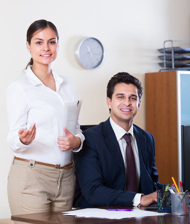 25s: Successful business team 25s smiling and posing in office Stock Photo