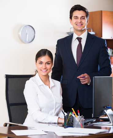 co operation: Successful business team smiling and posing  indoors Stock Photo