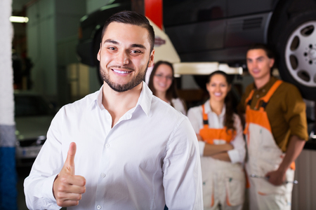 renewal: Smiling man client satisfied with mechanics renewal result