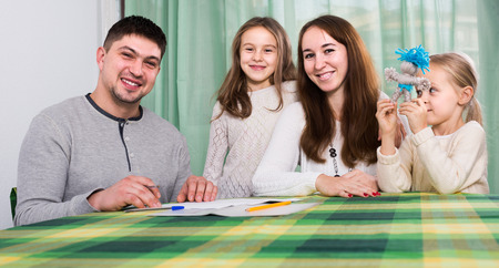 30 35: smiling parents with little children buying insurance and smiling