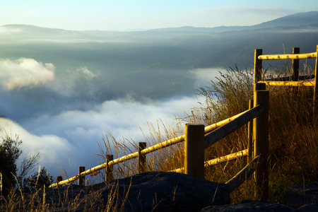 sil: Fog over  mountains in summer morning.  Galicia Stock Photo