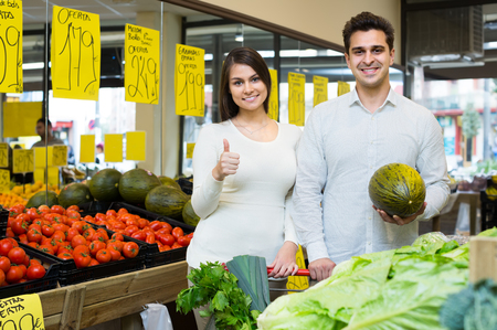 spouses: Happy young spouses choosing veggies in market Stock Photo