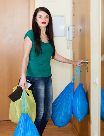 ordinary woman: Ordinary woman taking away the garbage out home Stock Photo