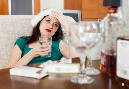 Suffering girl having headache in morning after party